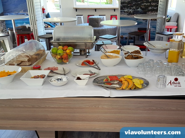 The delicious buffet breakfast at Ashanti Lodge takes over the pool table in the mornings!