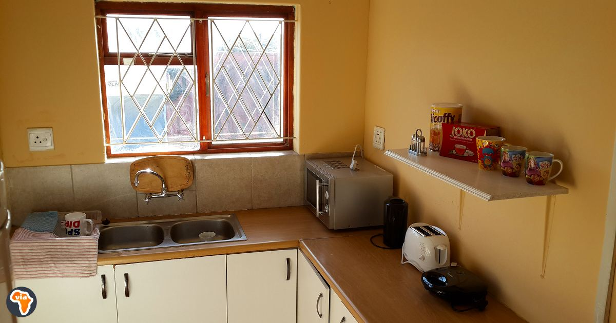 The kitchen area in the Via Volunteers flat at Baphumelele Children's Home.