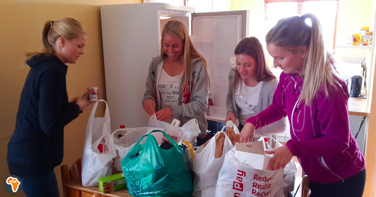 Unpacking the food for the week at the volunteer flat at Baphumelele Children's Home near Cape Town, South Africa.