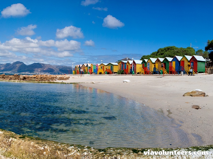 The colourful beach huts and the large tidal pool are a trademark of St James Beach.