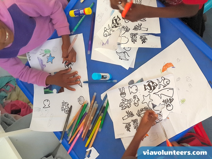 Want to volunteer abroad with Via Volunteers in South Africa? Colouring in at Fikelela Orphanage near Cape Town, South Africa.