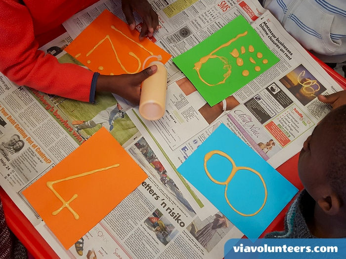 Want to volunteer abroad with Via Volunteers in South Africa? Writing numbers with puffy paint which gets cooked in the microwave!