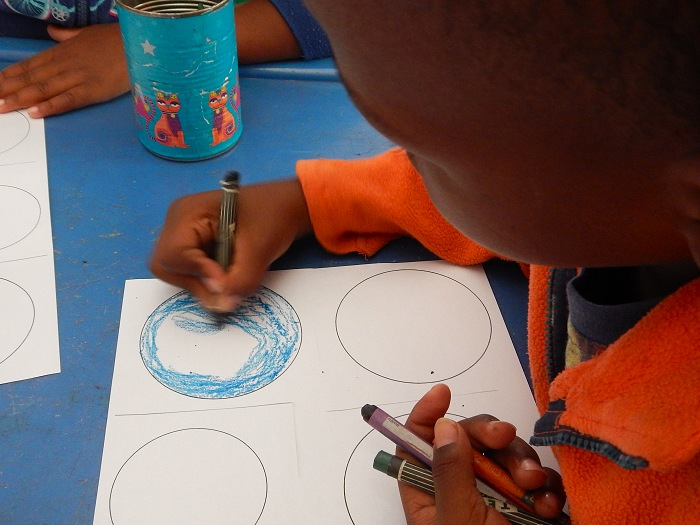Colouring in at Fikelela Children's home near Cape Town, South Africa.