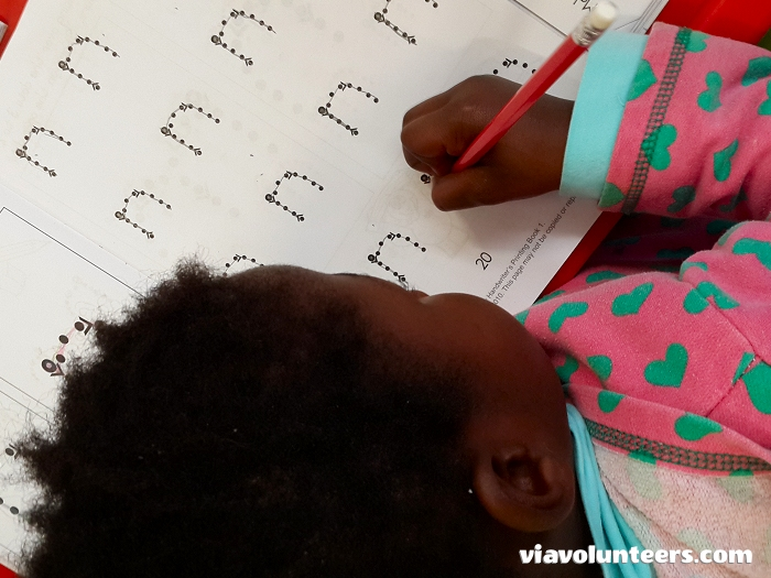 Practising handwriting at the  Fikelela Orphanage near Cape Town, South Africa.