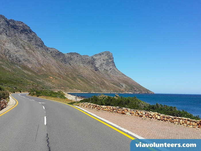 The scenic coast road from Gordon's Bay winds its way between the mountains and False Bay.