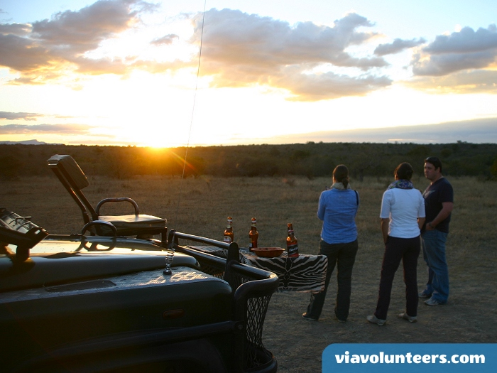 Sundowners in the African bush, the perfect interlude before a night drive.