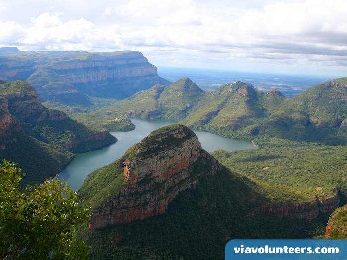 Travel through beautiful landscapes near Kruger National Park.