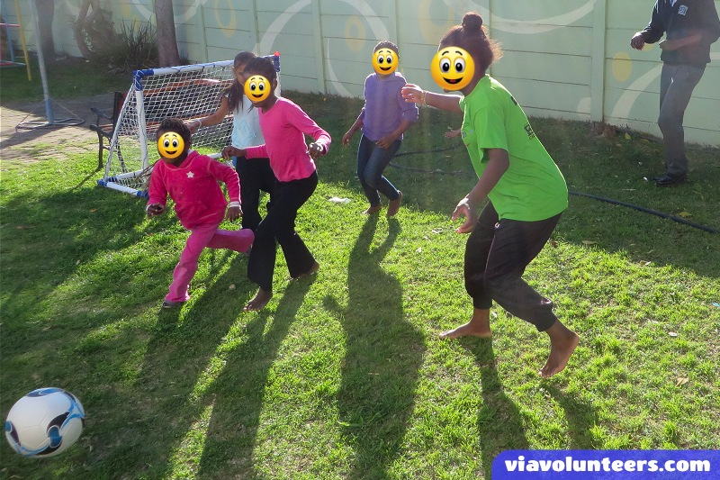Playing soccer with their new equipment donated by Kathy, one of our awesome volunteers!