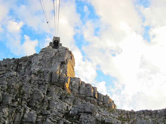 The cable cars take four to five minutes to reach the top of Table Mountain. The cable cars travel up and down the mountain every 10 to 15 minutes, ferrying up to 65 visitors at a time.